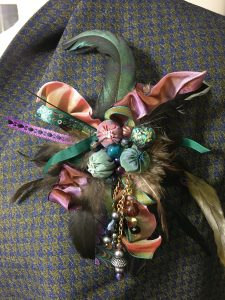 cluster brooch with iridescent feathers